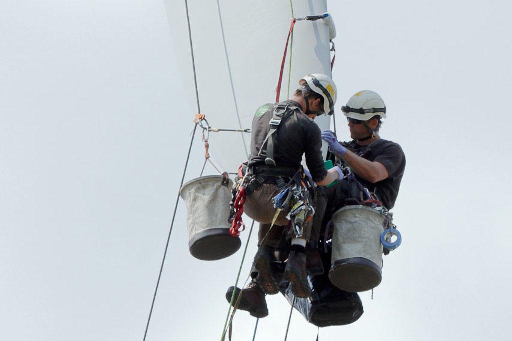 Wind Turbine Blade Repair - Two Technicians working on Fiberglass