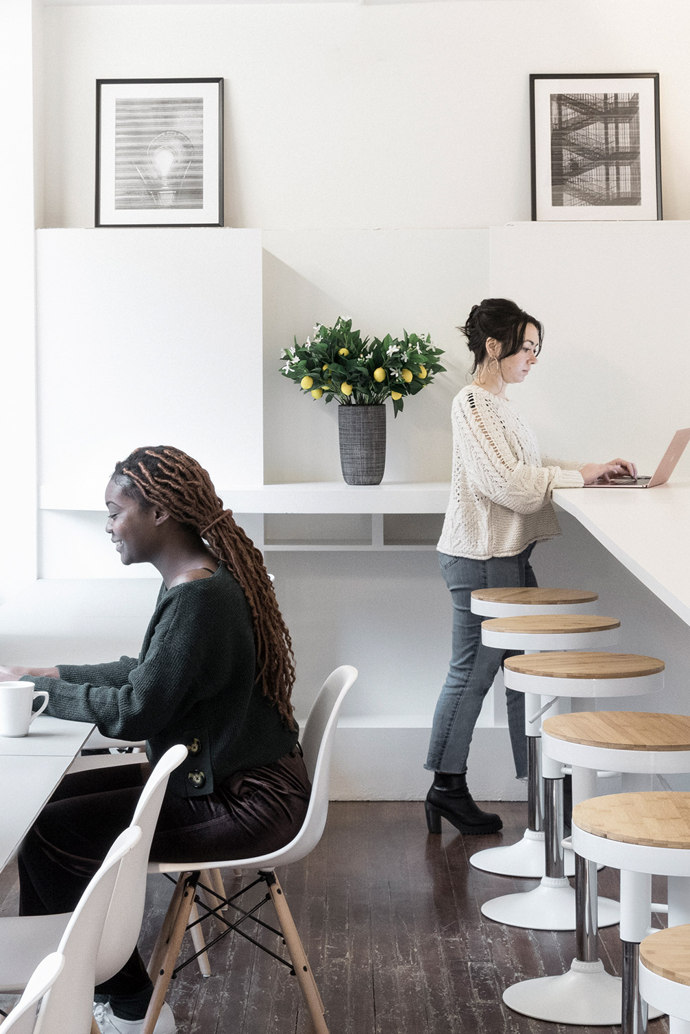 Two women talking in a Spacious space