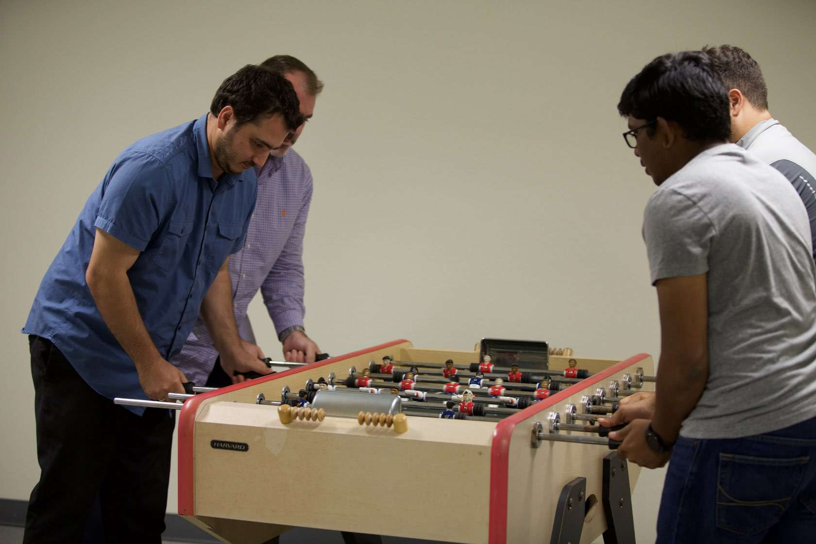 BlueCart employees playing foosball