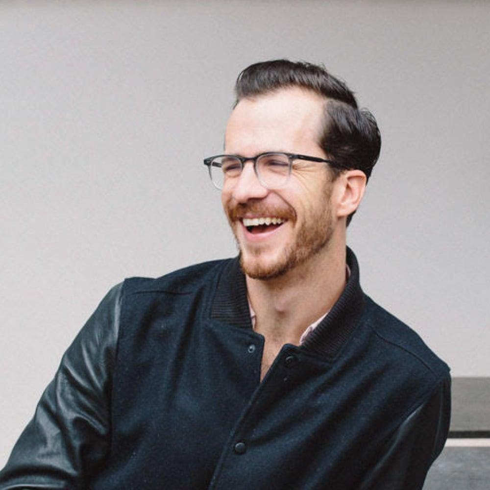 General Manager of Cafe Gratitude, Niels Tervoot, smiling