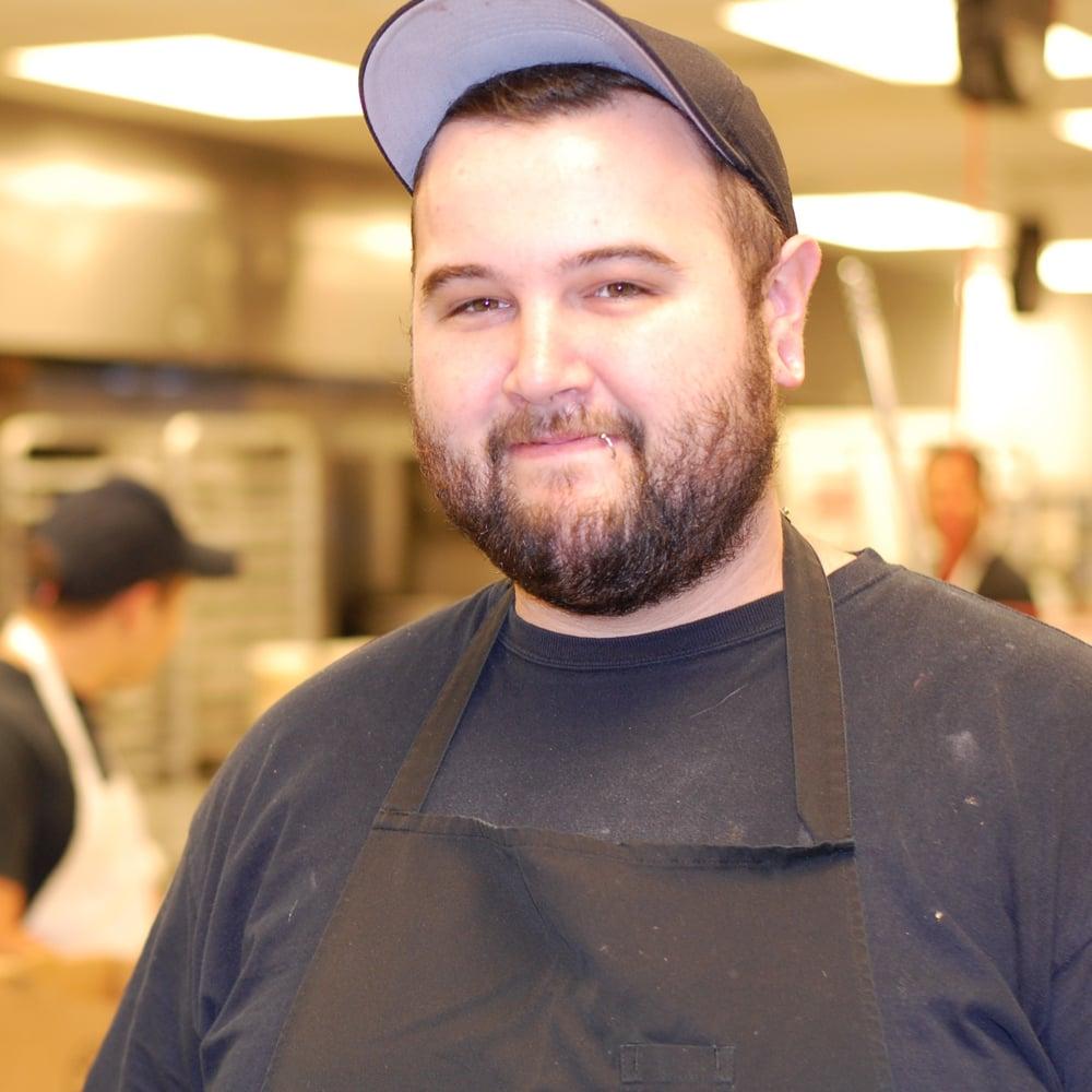 An employee at Neighborhood Restaurant Group