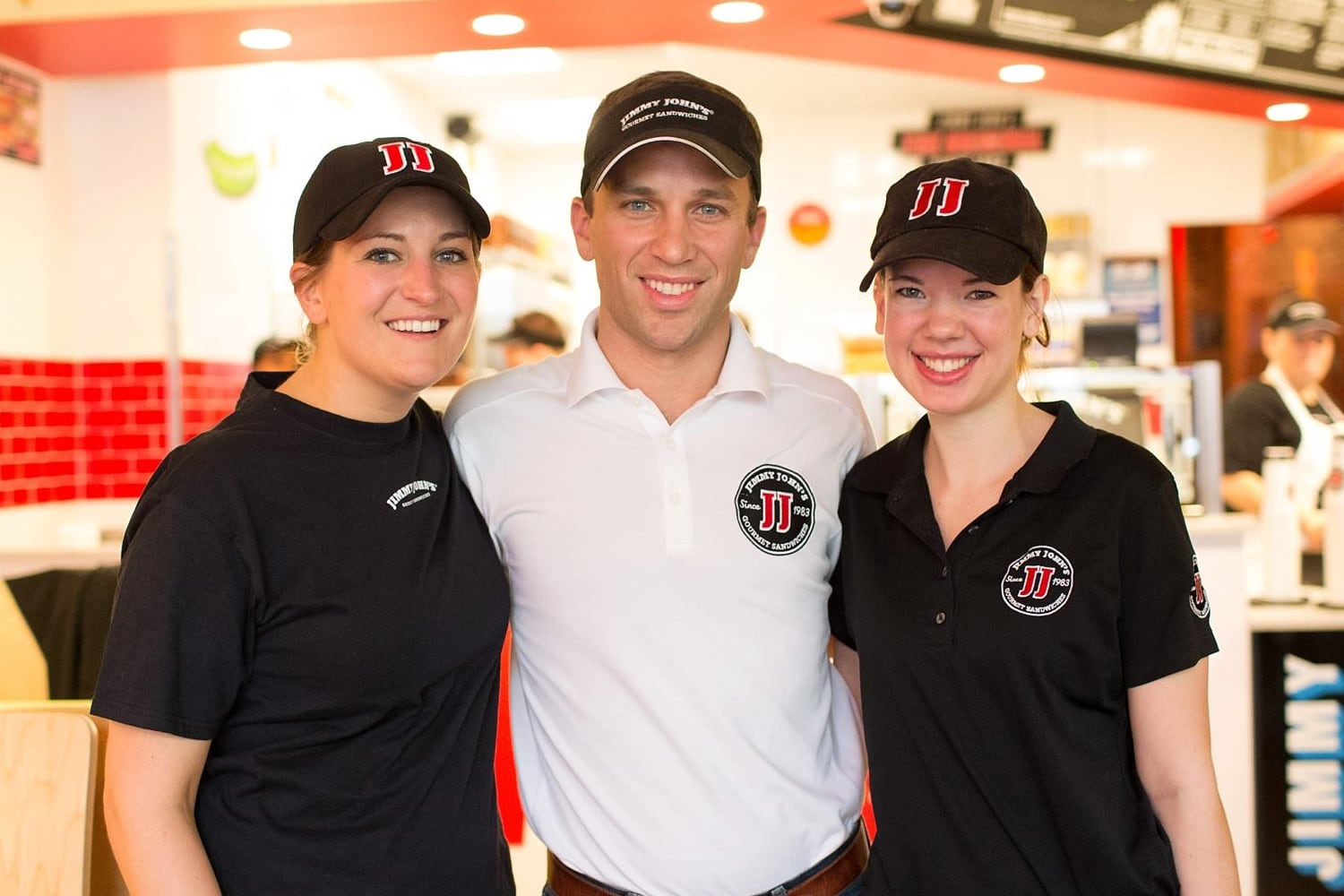 Jimmy John's franchise owner, Ben Stoltzfoos, with two employees