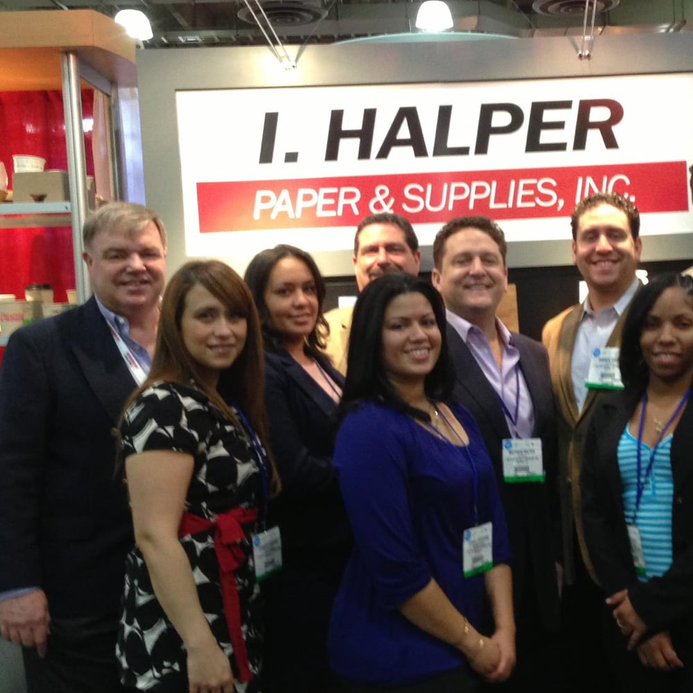 Group of I.Halper staff at a trade show in front of their booth