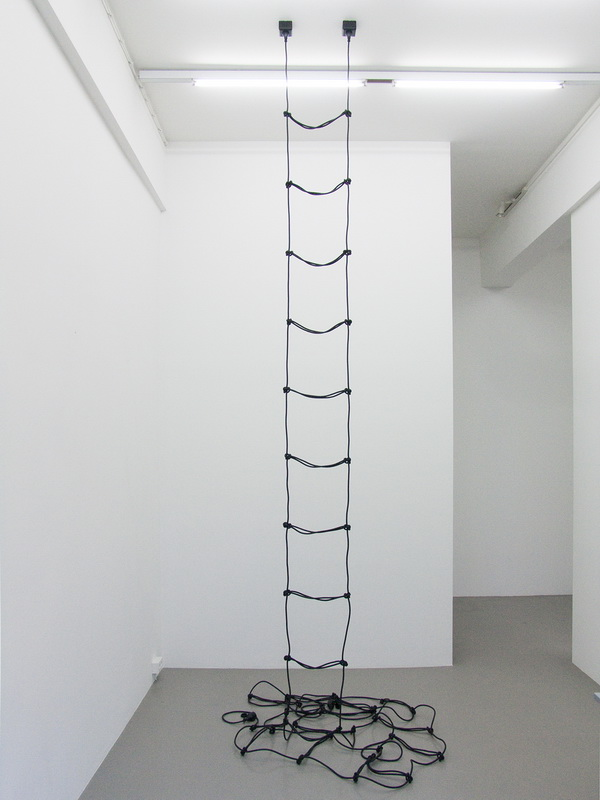 Leiter, made in 2010 is an artwork by Erik Andersen. The sculpture is made of two black cables. Here you see an frontal installation view at Charim Ungar Contemporary, Berlin.