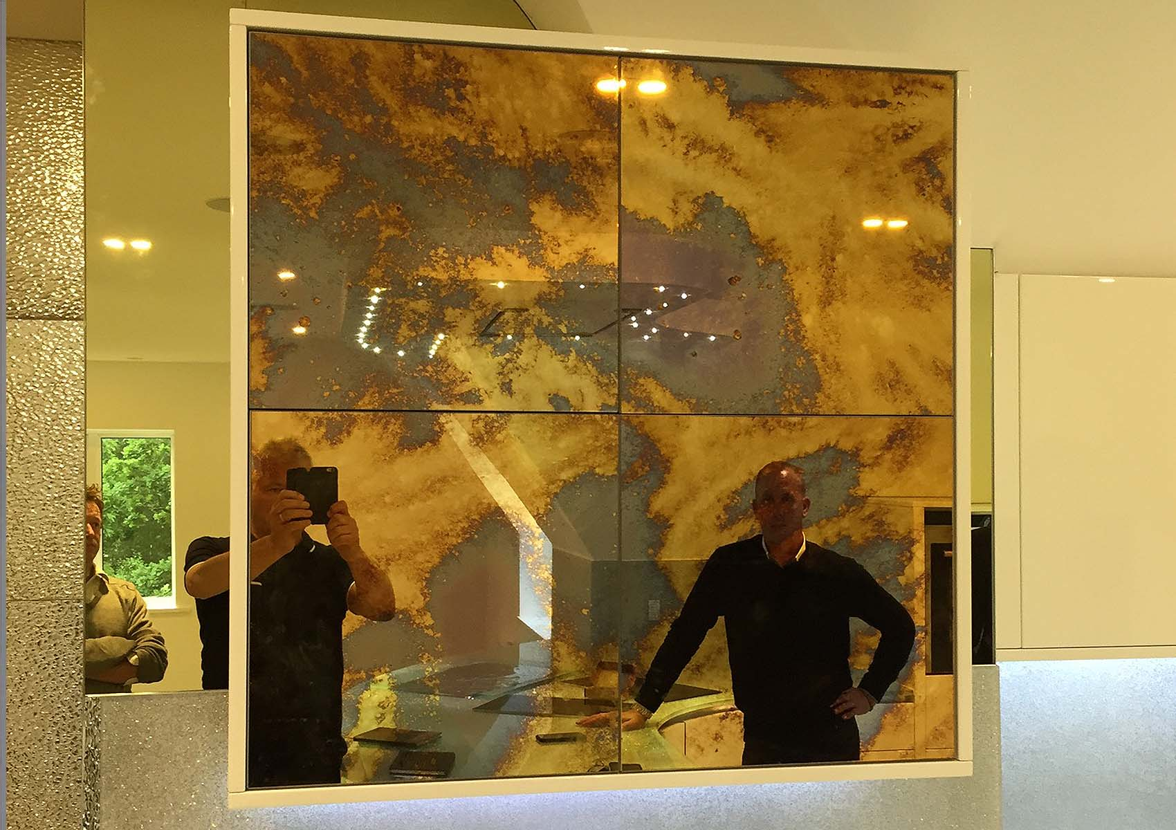 Byzantine style mirror glass feature wall with frame