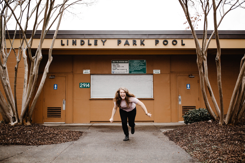 a girl outside a pool