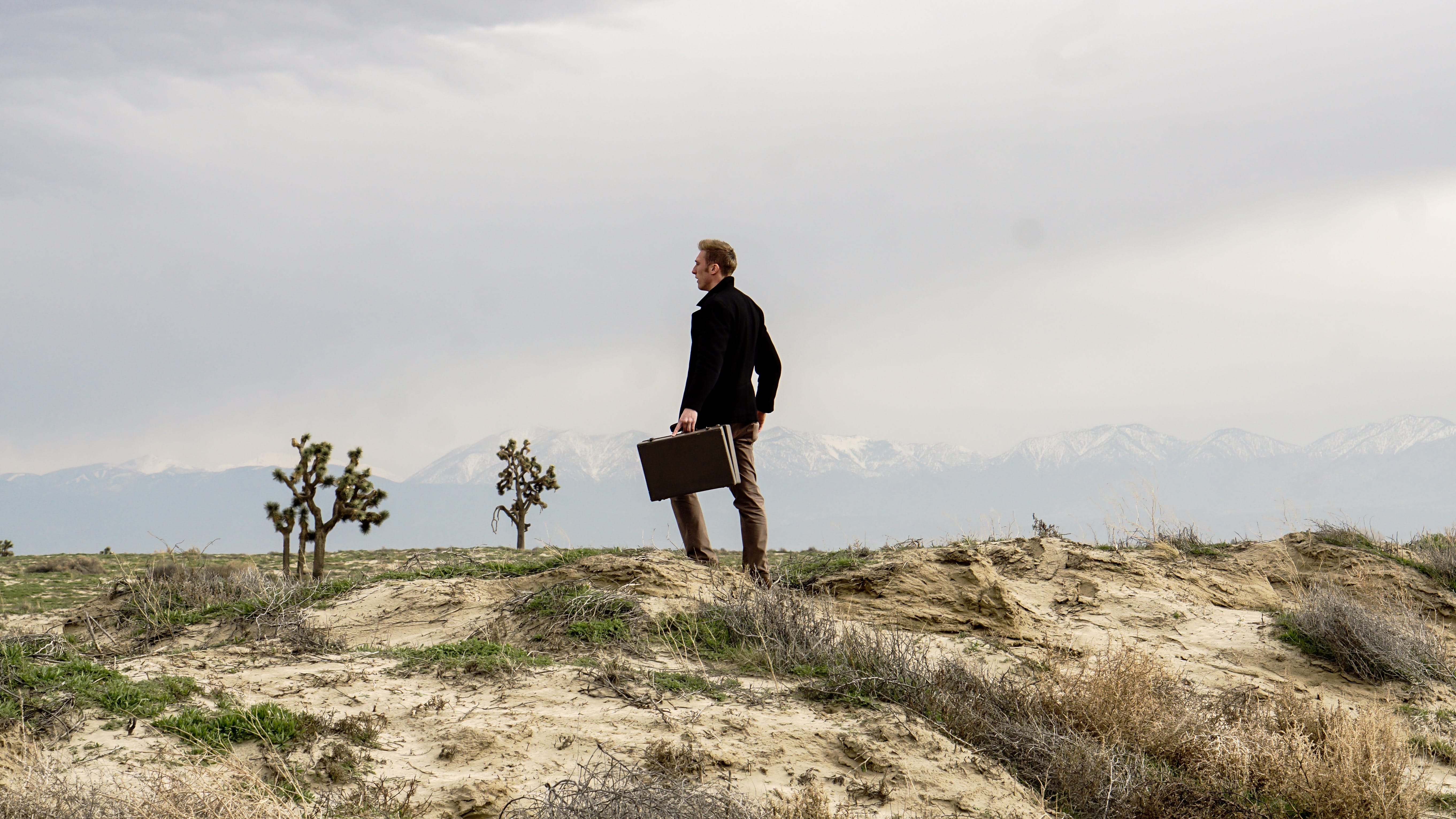 man with a briefcase in a desert