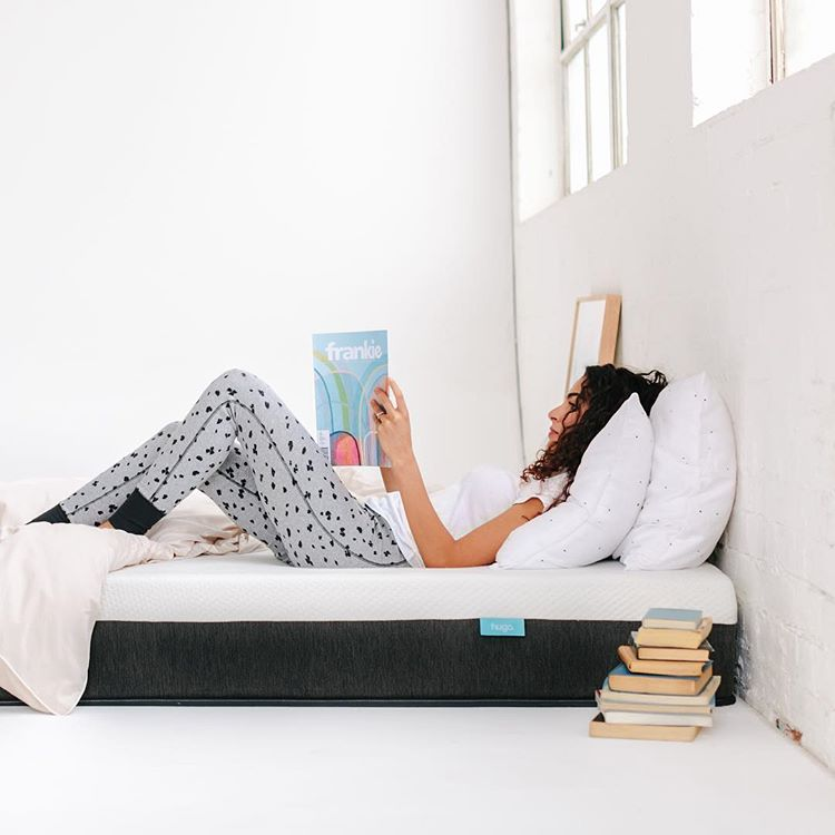 Women reading book on Hugo mattress