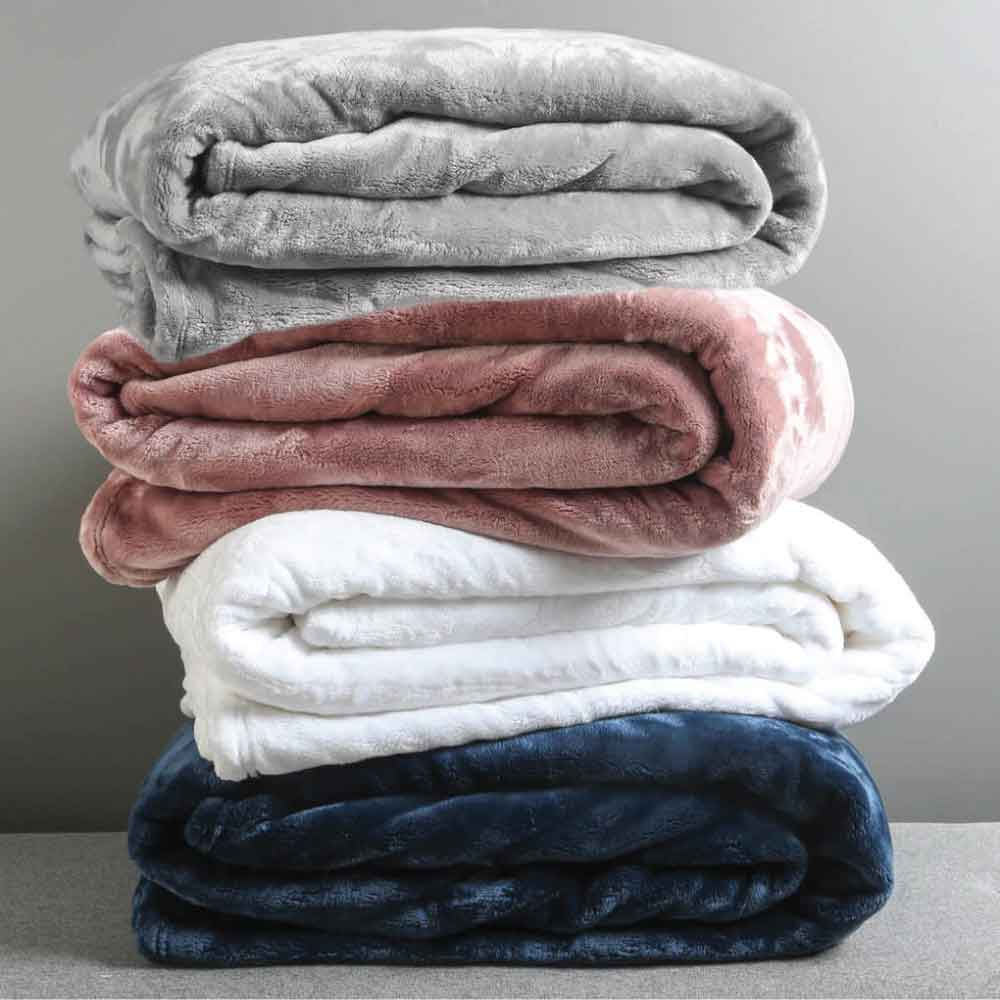 A pile of Luxe microfibre blankets