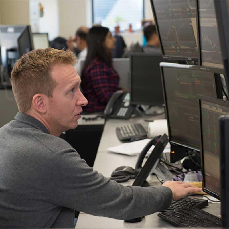 a rosenblatt securities employee at a work station