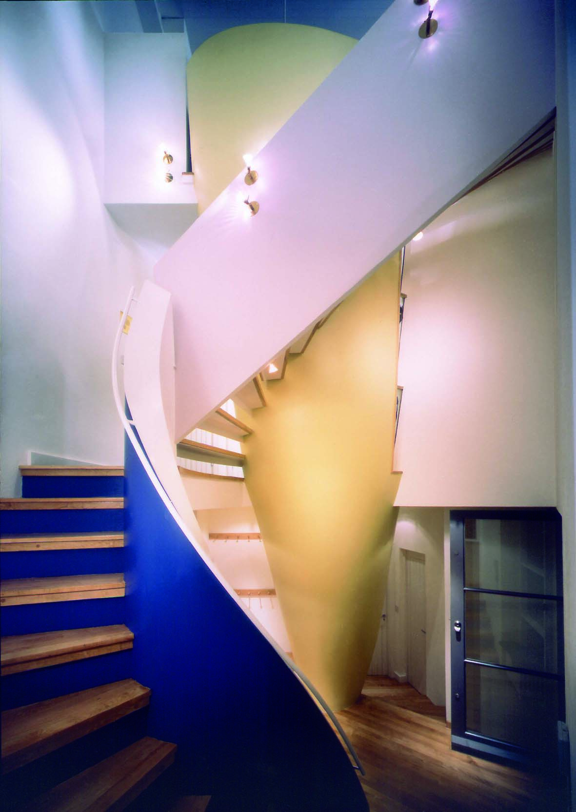 Colourful spiral staircase in 29 Doughty Mews by Ash Sakula Architects