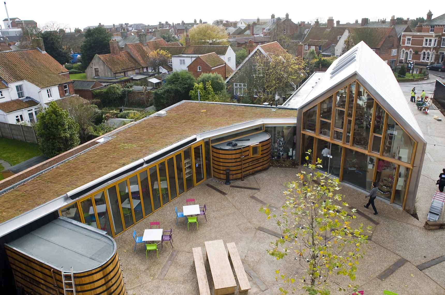 Aerial view of square showing reused groynes set into flooring and the green roof to the cafe.