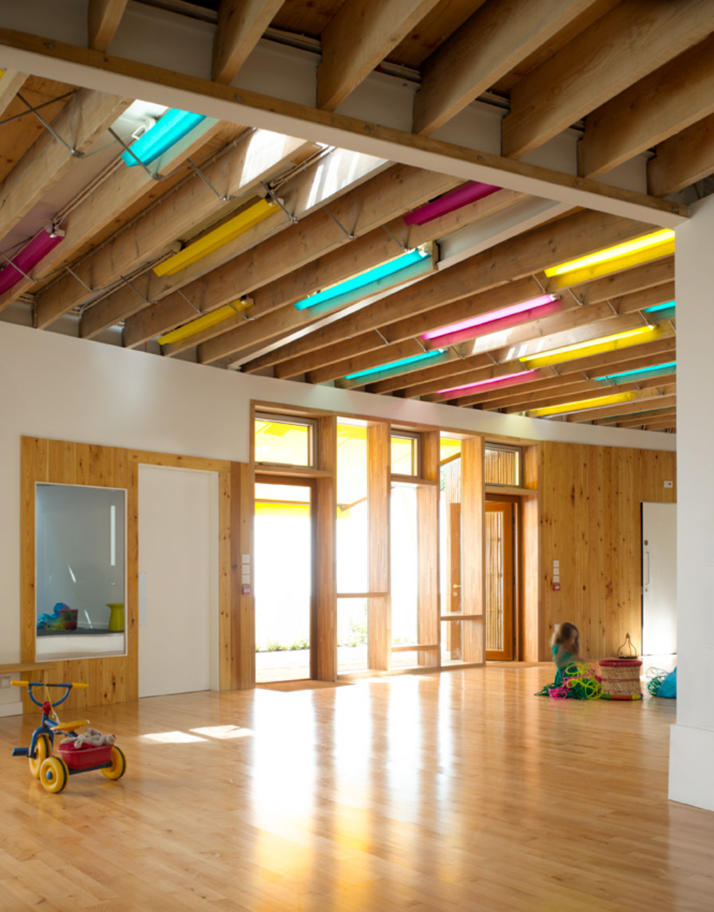Creche with coloured lighting in Carnival Arts Centre by Ash Sakula Architects