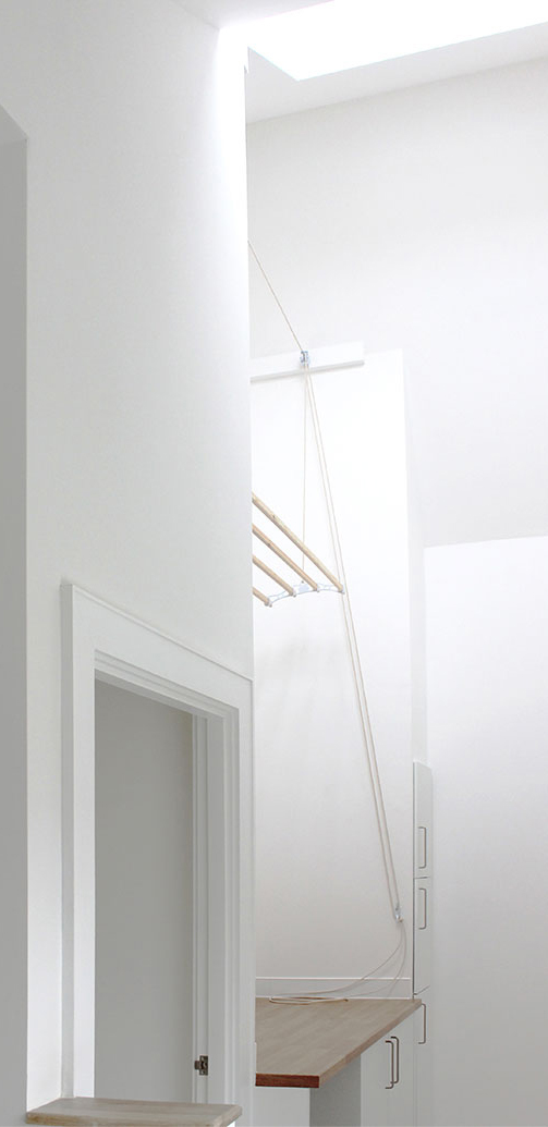 Exhibition Mews Ash Sakula interior view where landing doubles as laundry rack