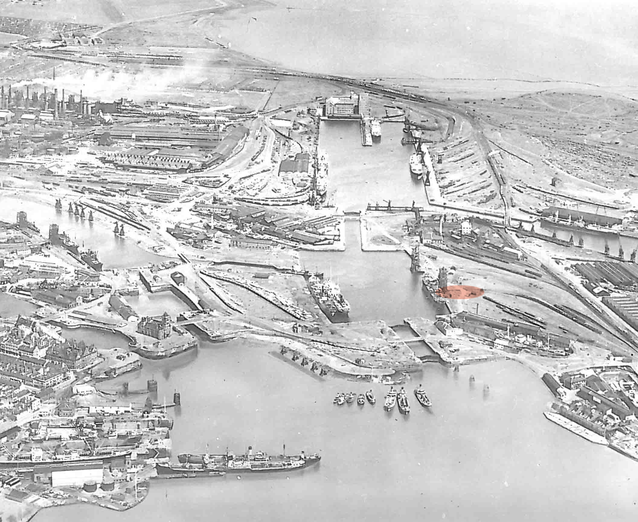 Historic aerial view of Cardiff Bay with the site of Gloworks by Ash Sakula Architects