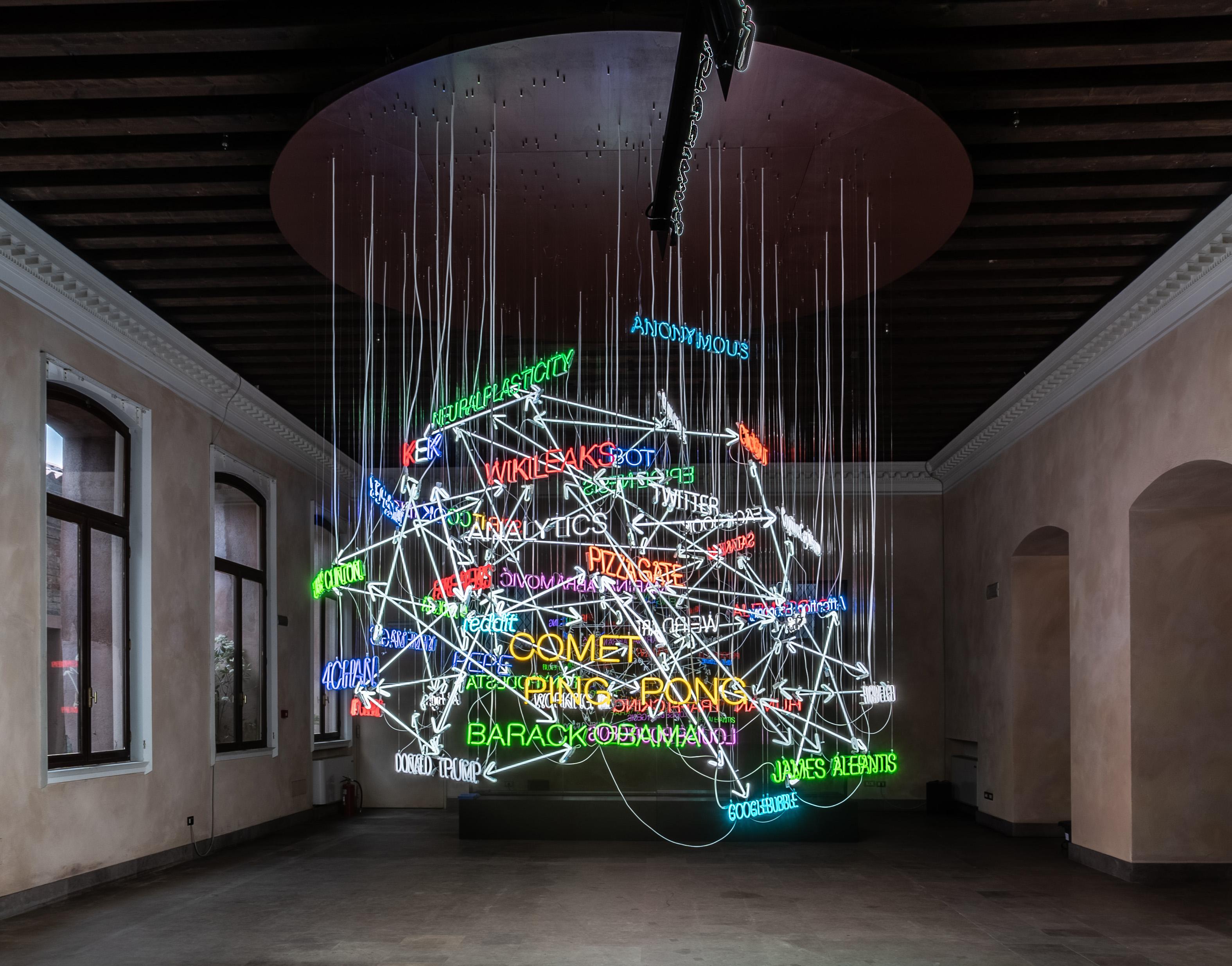Warren Neidich. The Pizzagate Neon (2019). Installation view, Rumour to Delusion, Zuecca Project Space, Venice Biennale 2019. Photo: Warren Neidich. Courtesy of Priska Pasquer Gallery, Cologne.