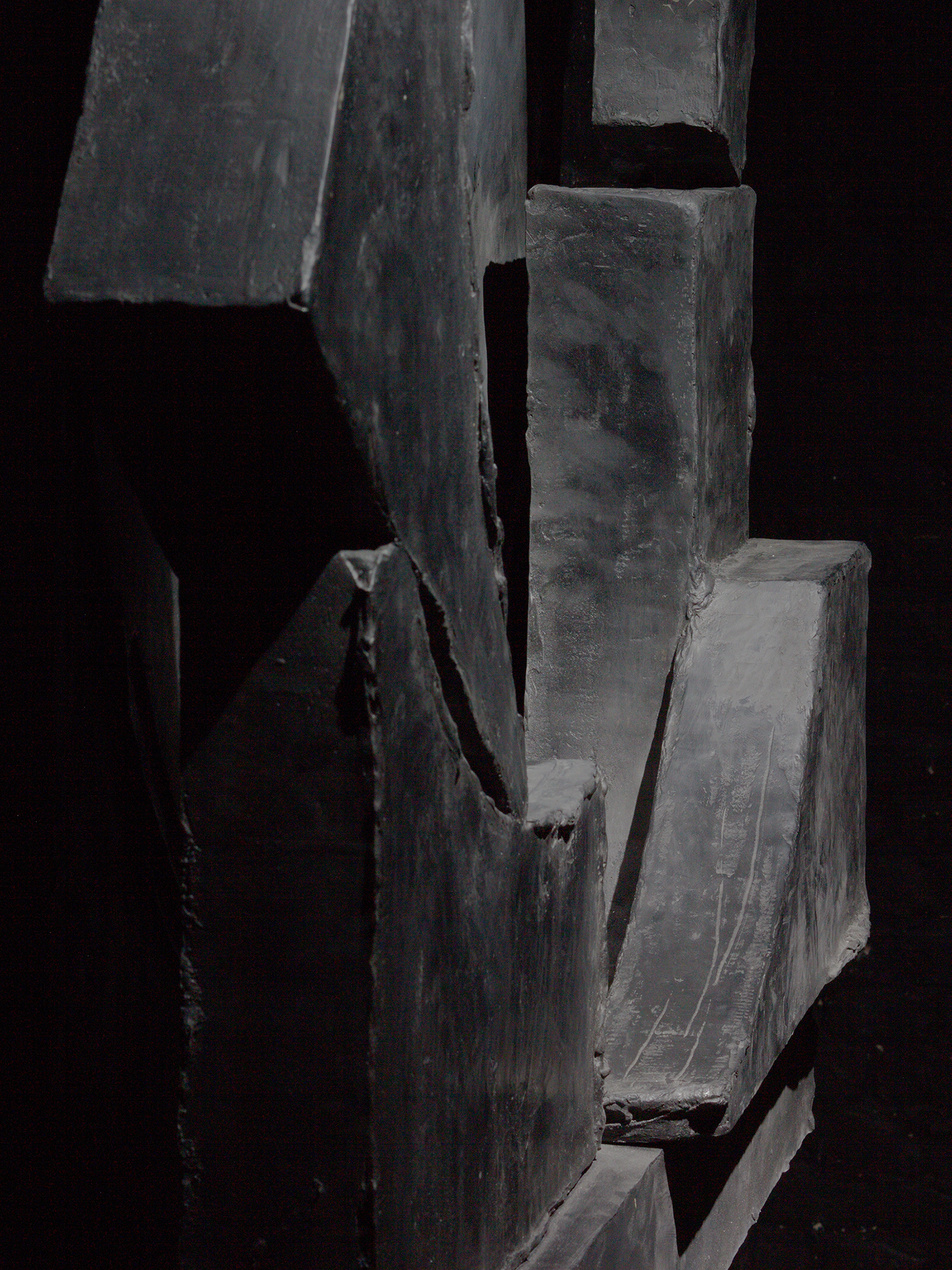 "Detail of ""Teresa"", a black, abstract sculpture made of epoxy resin and black pigment by Erik Andersen"
