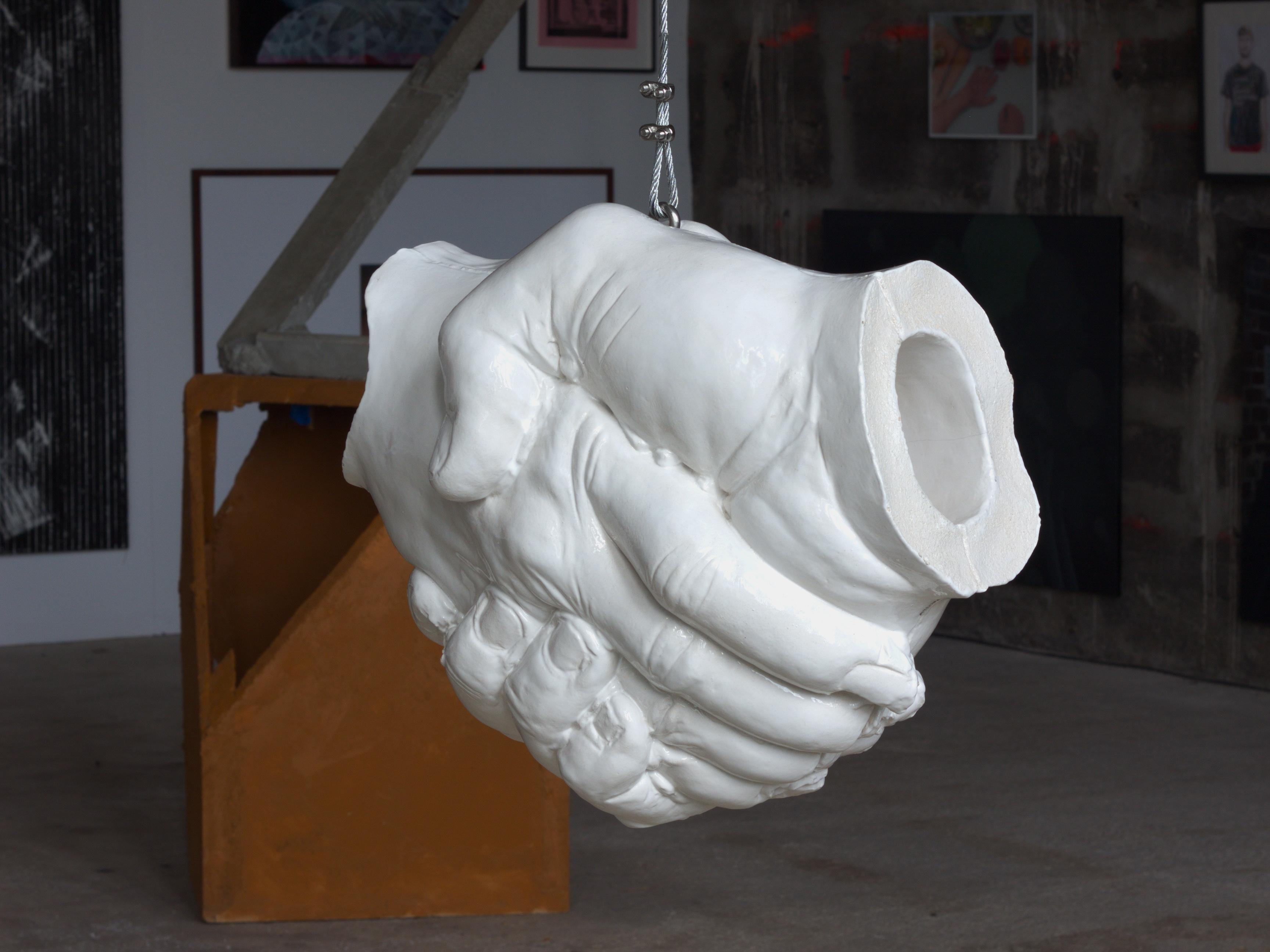 Handschlag, 2010 - white glazed Ceramik sculpture by Erik Andersen - Installation view at Kunstverein Familie Montez, Frankfurt
