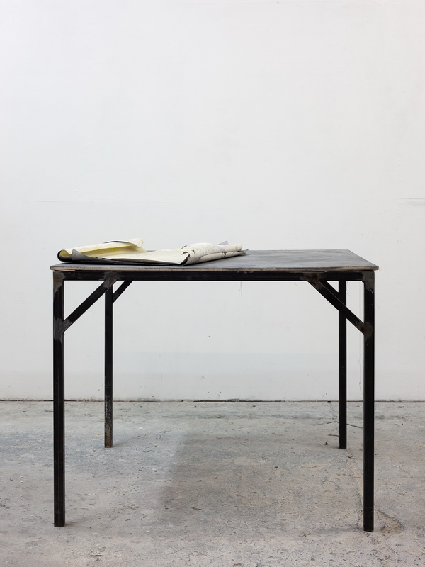 upcoming exhibition announcement / some sheet of papers on a table in the studio of erik andersen in berlin