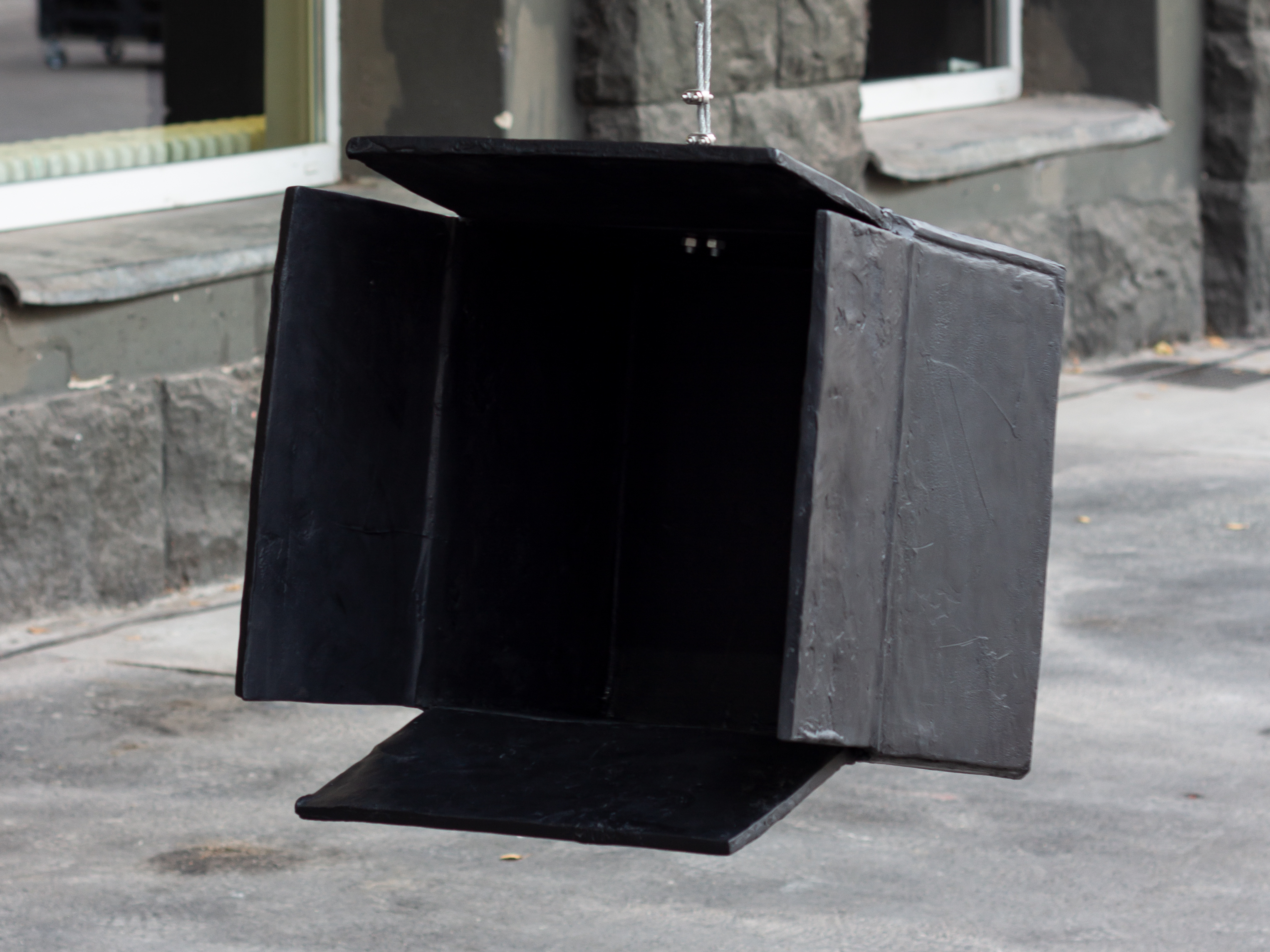 Black Hole is a black sculpture by Erik Andersen. The artwork is made of epoxy resin.