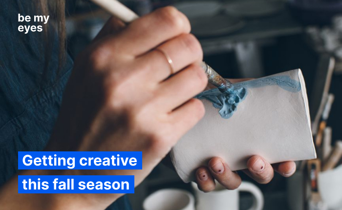 """Woman painting a mug made out of ceramics. Text reads: """"Getting creative this fall season""""."""