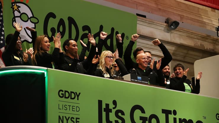 Wall Street's top analysts are betting on stocks like GoDaddy and Carvana to beat the market