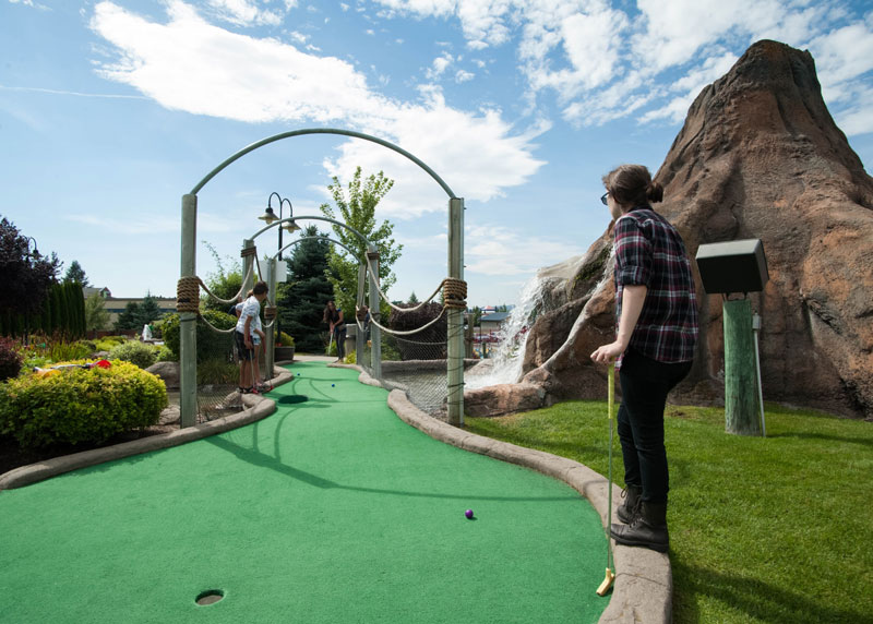 People playing miniature golf outside