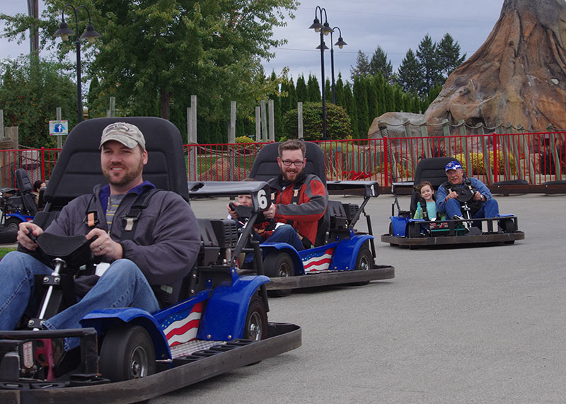 People racing go-karts