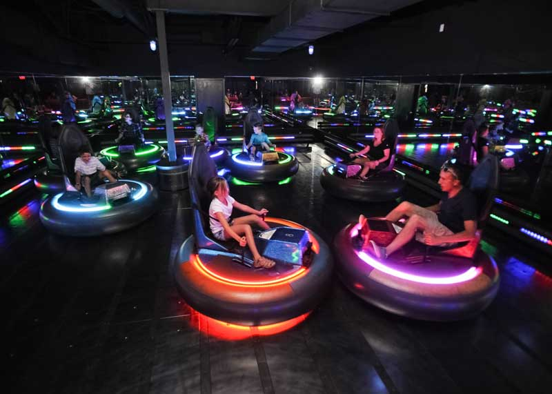 People riding bumper cars