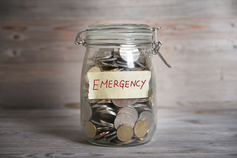 A emergency fund inside a glass jar