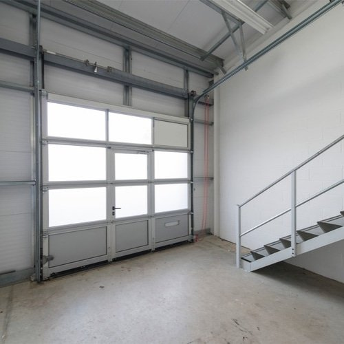 Empty unit space showing loading access door