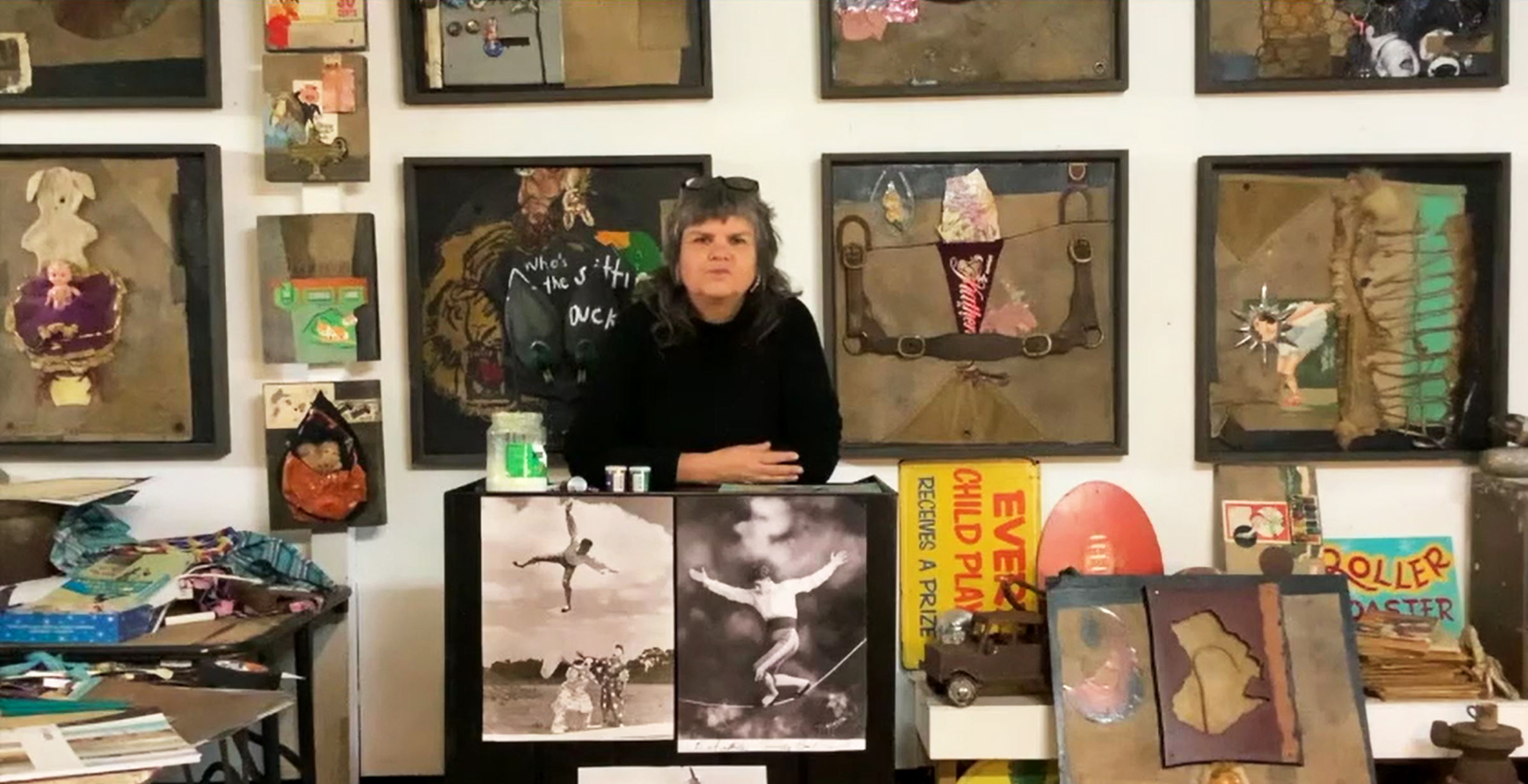 Karla Dickens in her studio, surrounded by her artworks
