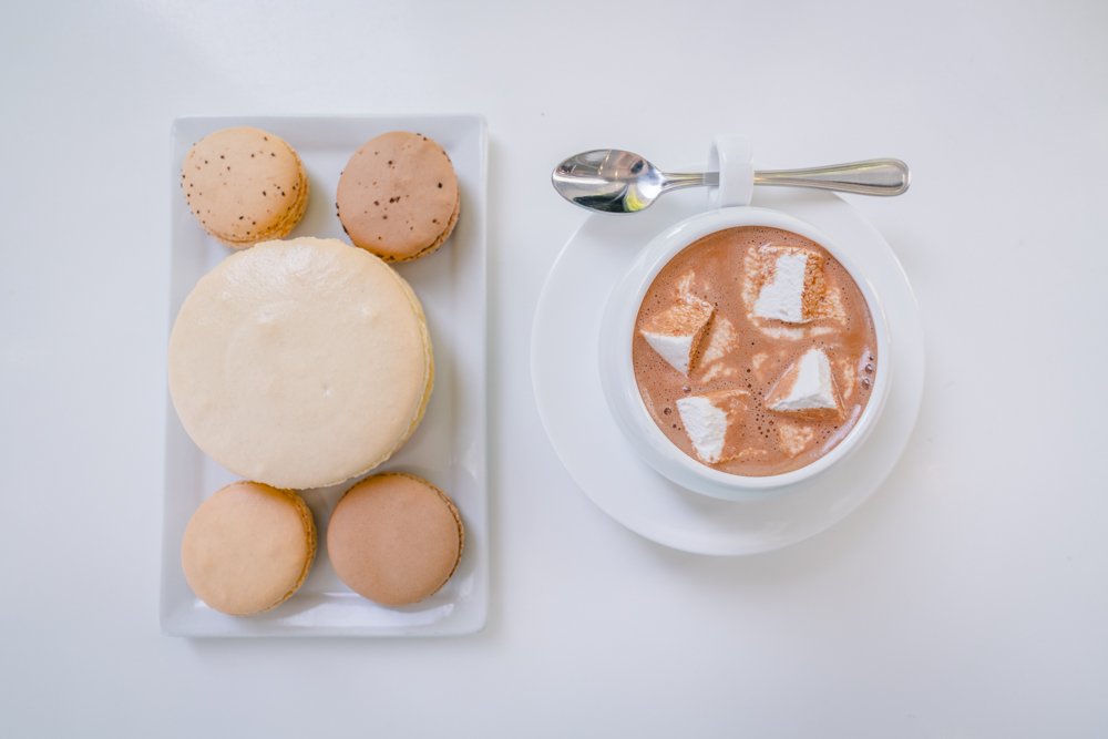 A table full of hot chocolate and macarons at Ginger Elizabeth's in Midtown Sacramento for Visit Sacramento.