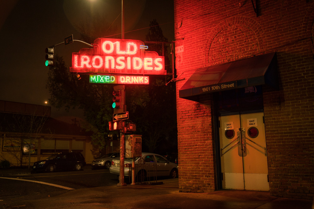 A neon light shines outside of Old Ironsides in Midtown Sacramento for Visit Sacramento.