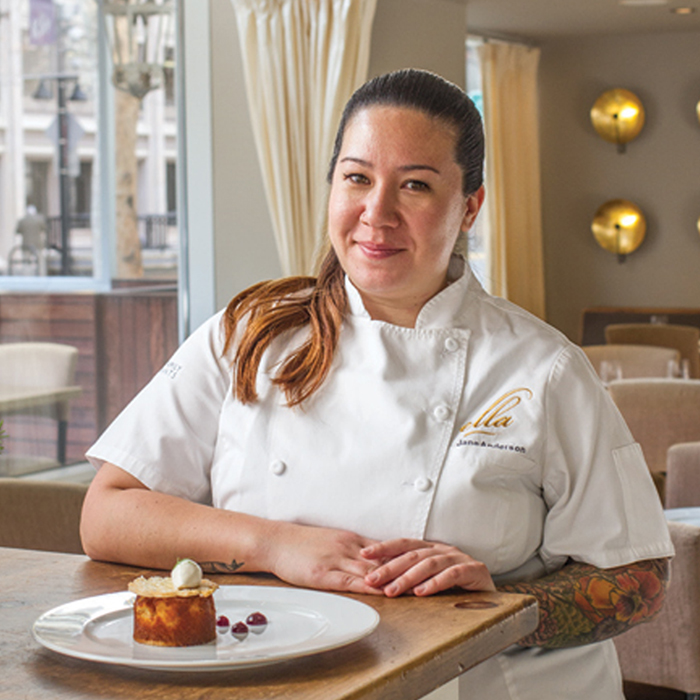 Chef Jane Anderson sits behind a pastry at Sacramento's Farm to Fork restaurant Ella in Downtown for Visit Sacramento.