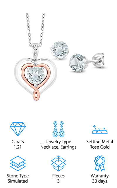 The last set on our list has a pendant necklace and earrings. The pendant is made with a 1-carat diamond! That's pretty amazing, and definitely puts this set a step above the rest. It's a heart-shaped pendant that is made of white gold on the bottom layer, with a heart in the middle that is made of beautiful rose gold to add an accent. Inside that heart is the large diamond, brilliantly cut in the round. These diamonds are natural diamonds and combined with the simple diamond stud earrings, they weigh a combined total of about 1.2 carats. That's a lot for a set! The pendant comes with an 18  d-inch white gold chain with a spring clasp so it's always secured perfectly. Together, it's a beautifully sparkly set that's unique and eye-catching. We love this design and we are sure that you or the person you love will as well! It's classic and dainty!