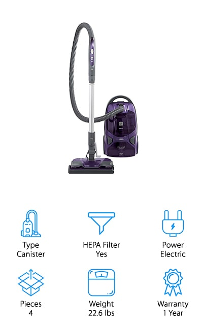 The Kenmore 81614 Vacuum is our second canister model on our list with excellent carpet vacuum reviews! This vacuum has 2 motors to give you more suction power as you clean your floors. Inside you'll find a high-efficiency filter to keep the dirt, dander, and allergens out of your home. Two floor nozzles are included for deeper cleaning and to reach hard to clean places. The motorized pet brush is made to grab pet dander deep inside your carpet for a spotless clean every time. When you need to change your brushes, there's no need to bend over, just pop the brush in and go using the vacuum's brush storage. You'll also receive two versatile cleaning tools to help you clean furniture and crevices you can't reach with the other attachments. Easily retract the cord when you're done cleaning to store it away nicely in the vacuum's cord storage compartment. All in all, the Kenmore 81614 Vacuum may look different but it does the job just as effectively as any other vacuum!