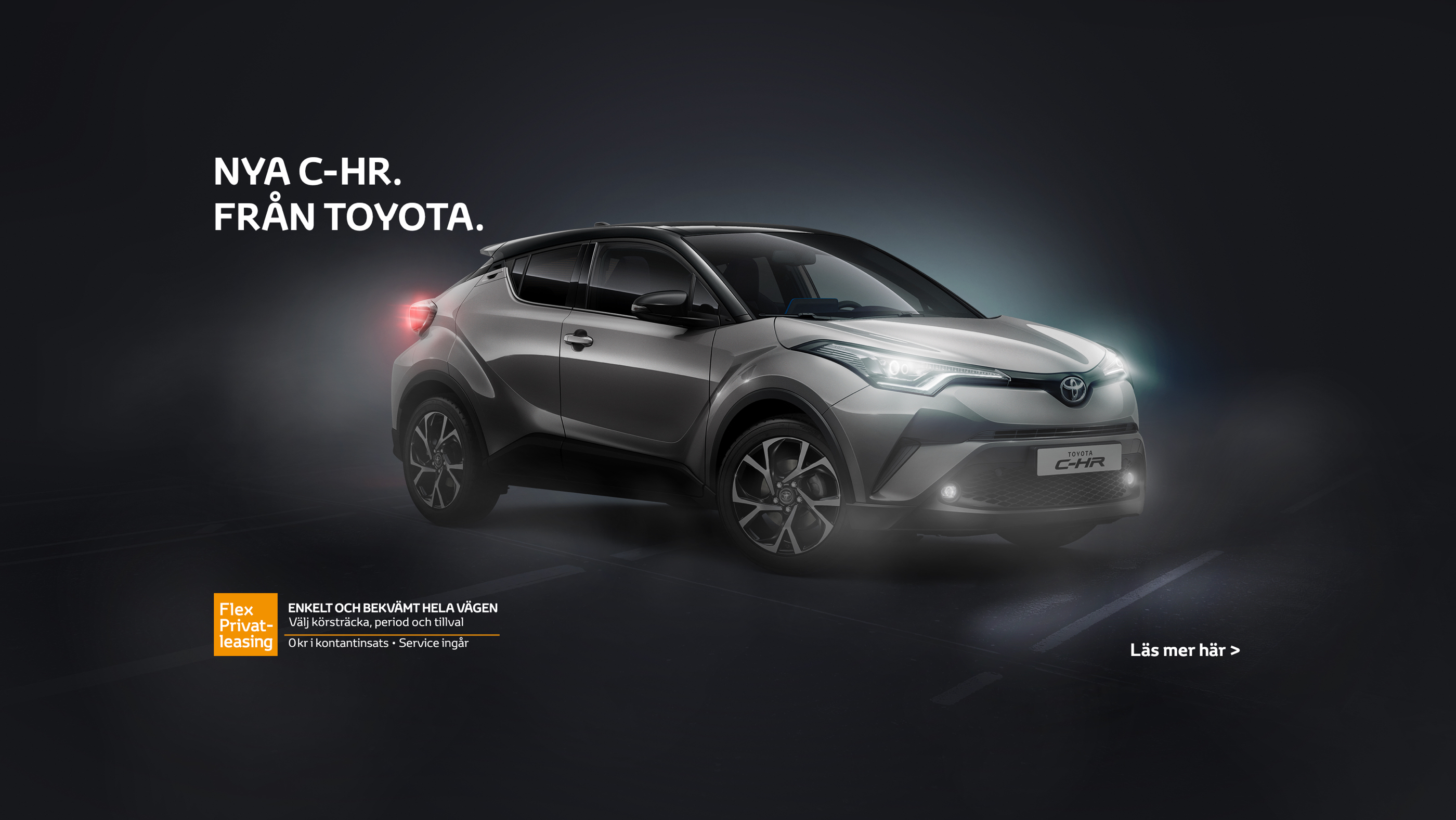 A gray Toyota C-HR on black background.