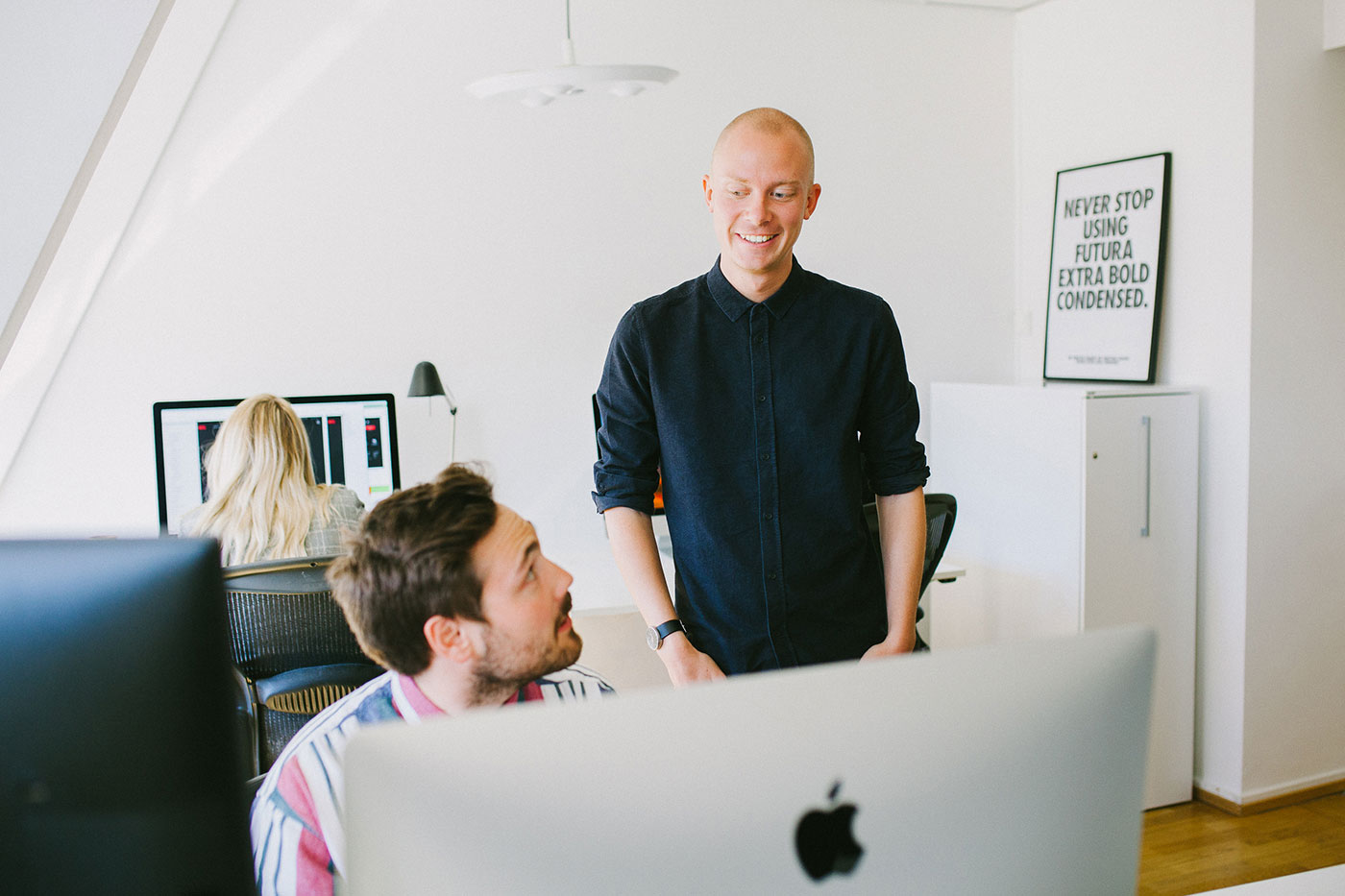 Designers Fredrik and Lukas discussing creative processes in the Stockholm office.