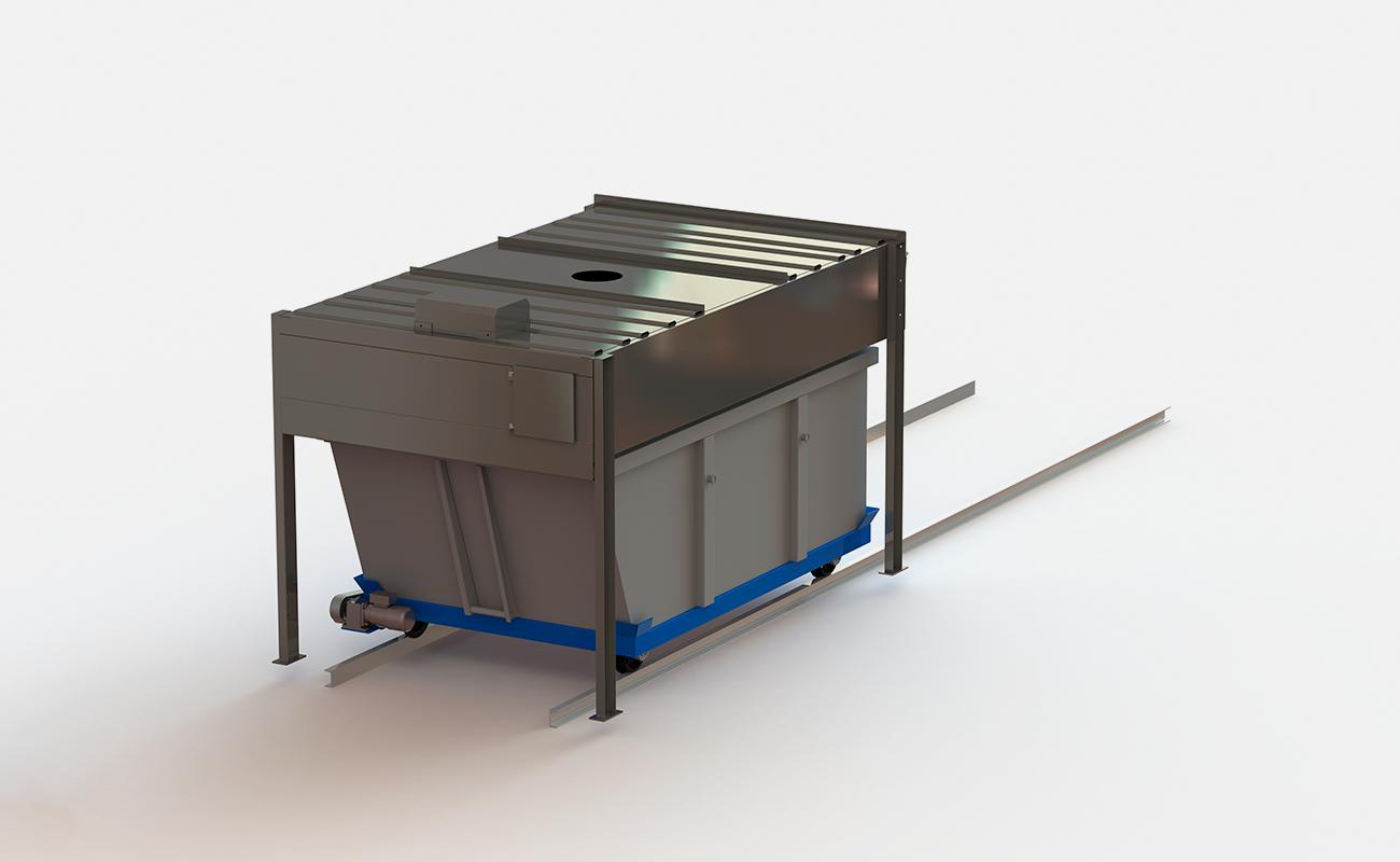 Under slamfylling står container parkert under ventilasjonshette