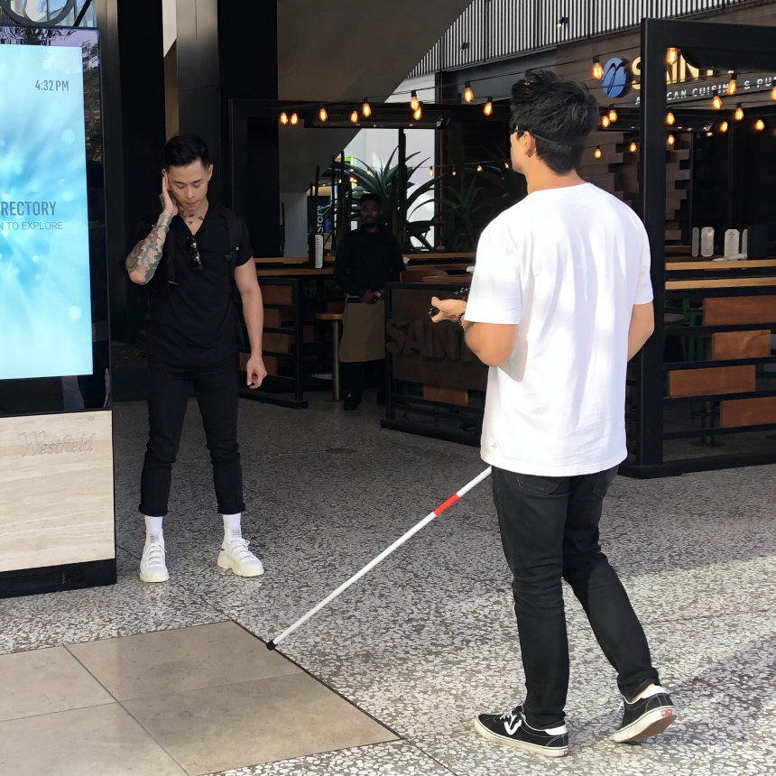 This was Chase Nguyen and myself testing the experience of a visually impaired individual visiting the mall by using a cane, specifically for V.I. folks, and a blindfold.