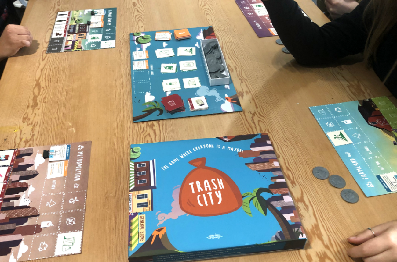 Trash City coming to fruition through observing students playing our board game against one another at the Santa Monica College campus.