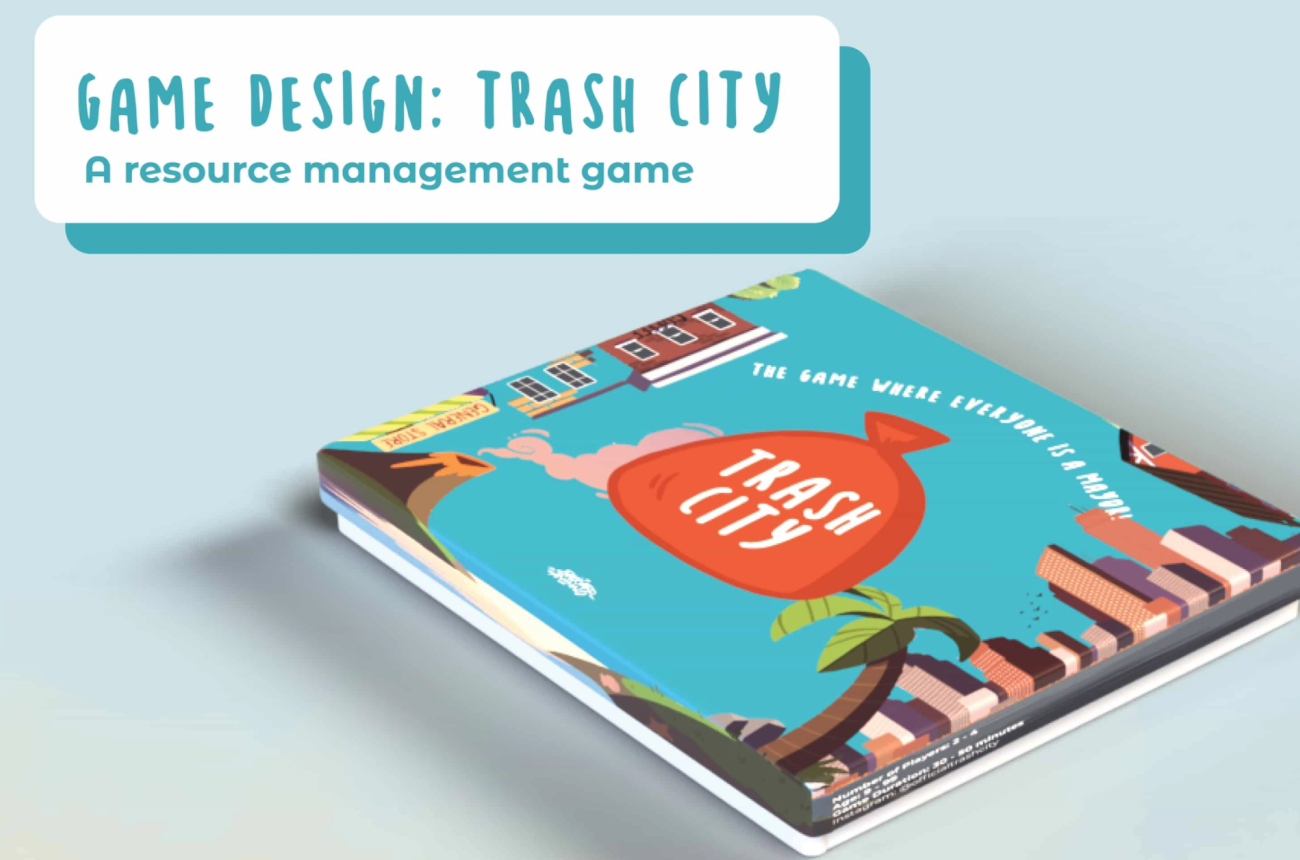 """A board game box with the scenery of a city, and the logo """"Trash City"""" on top."""