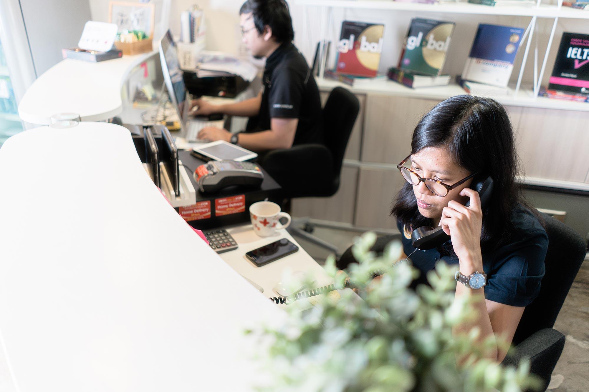 Student advisors at Speak English Institute in Dubai answering calls.