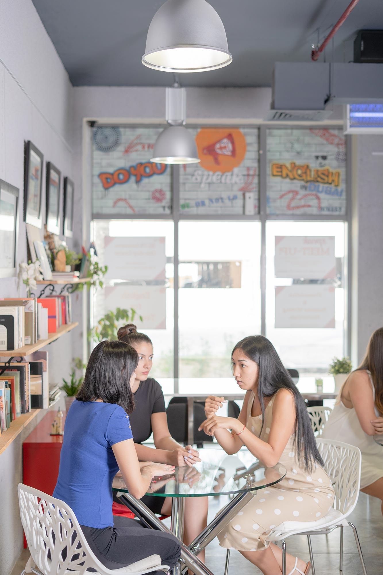 English students sitting at a table at Speak Dubai