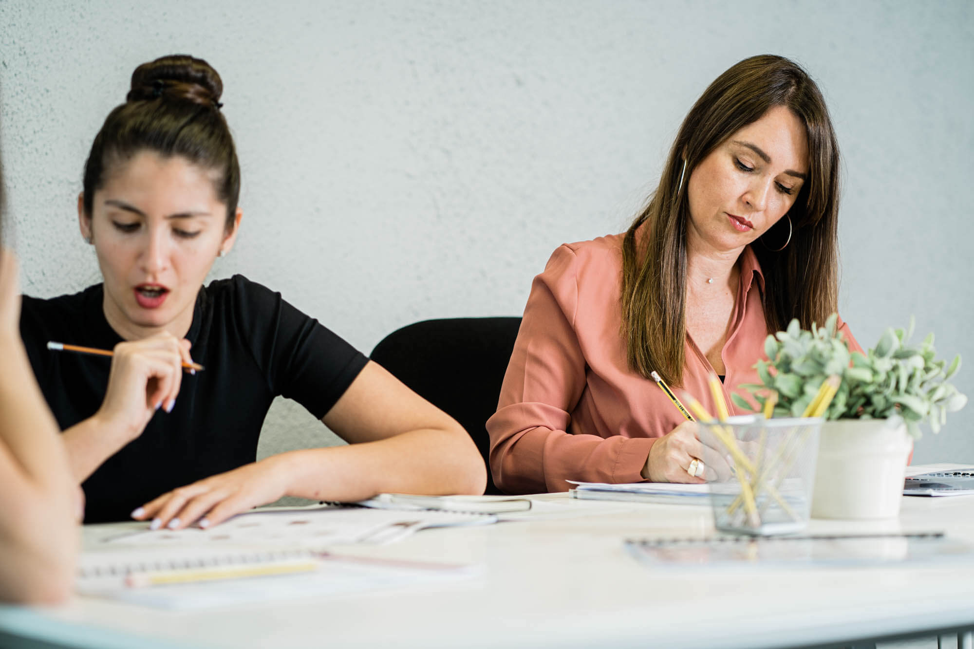 two female students studying business English in Dubai