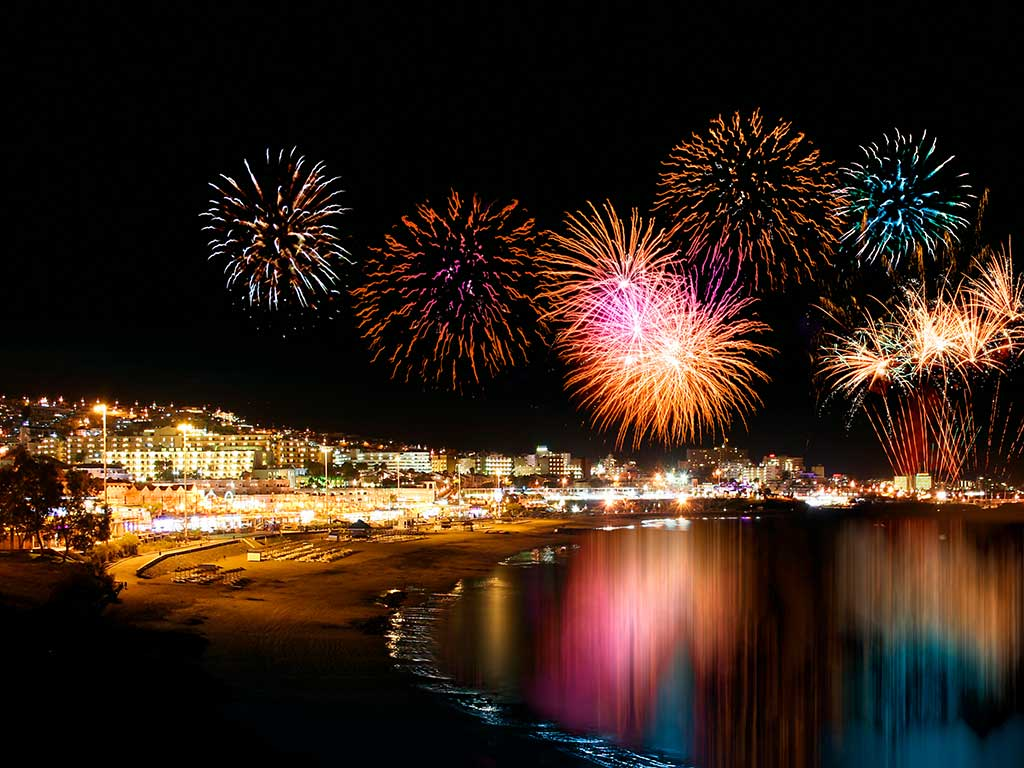 Beach with fireworks celebrating New Year's