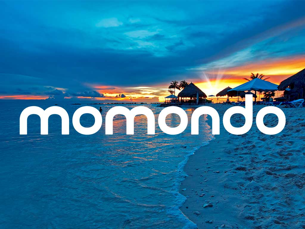 Beach in Curaçao with Momondo logo overlay