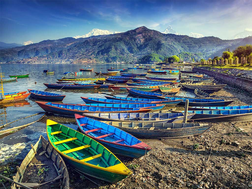 Colorful boats alone the shore in Nepal