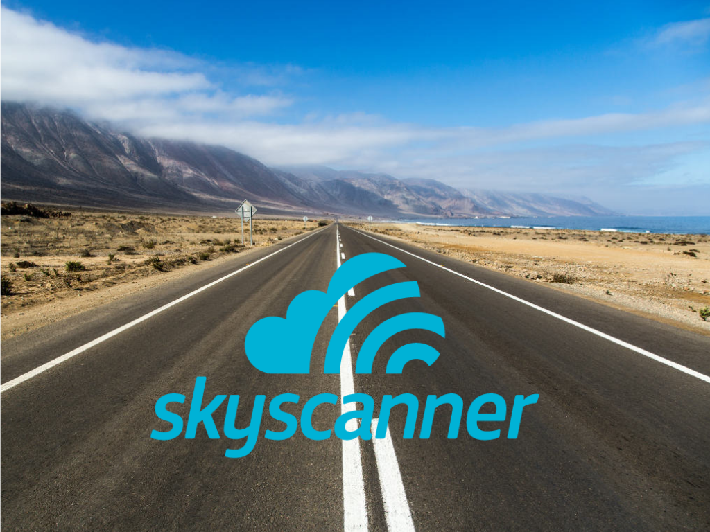 Skyscanner logo on photo of open road with mountains